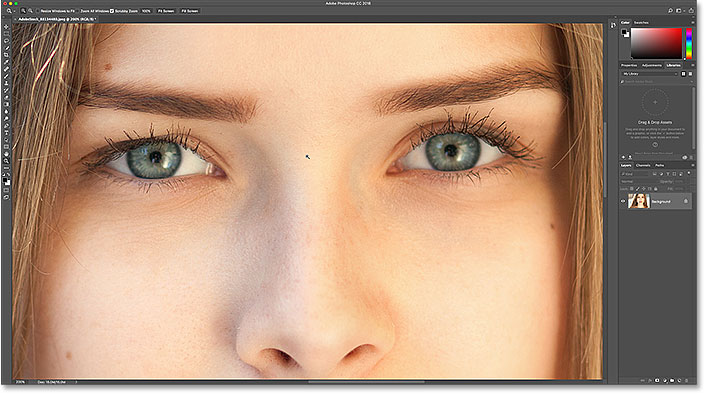 Zooming in on the eyes with the Zoom Tool in Photoshop.